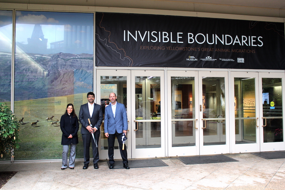 "WMI co-sponsored the ""Invisible Boundaries"" exhibit with National Geographic, Yale School of Forestry and Environmental Studies, and the Buffalo Bill Center of the West. From left to right are Wyoming Nature Conservancy ecologist Holly Copeland, WMI director Matthew Kauffman and WMI Research Associate Hall Sawyer."